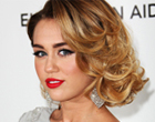Miley Cyrus combined the sweet caramel hair colour with gorgeous waves and striking make-up...