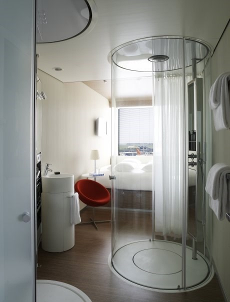 Small but mighty 11 tiny hotel rooms that maximize space for Hotel amsterdam cube