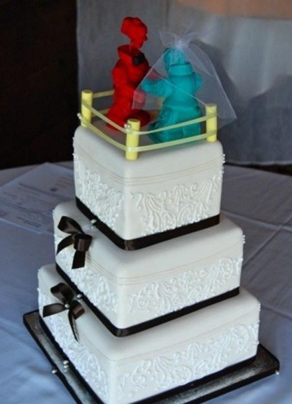 34 of the funniest wedding cake toppers weve ever seen slice rockem sockem romance junglespirit Images
